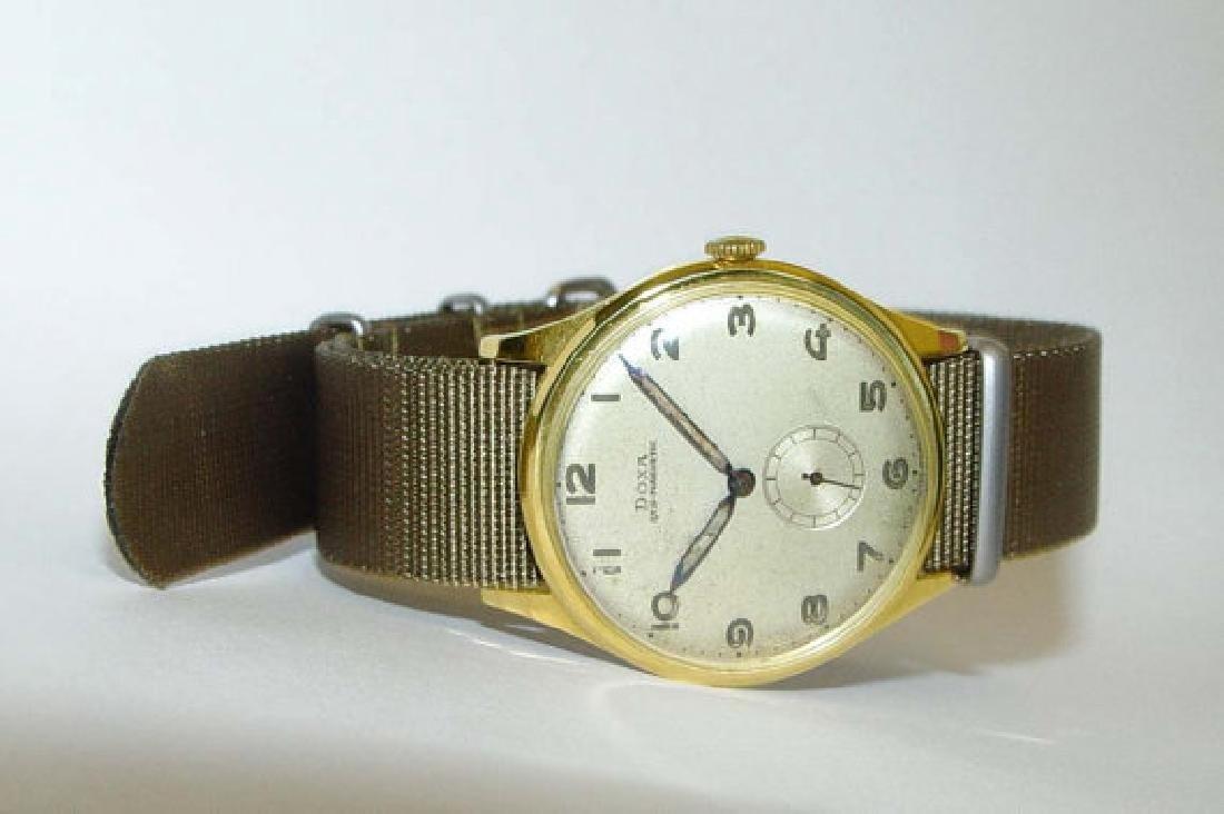 1940s 14kt Gold Doxa Bubble Back Nato Strap Wristwatch