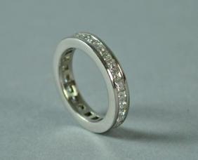 PLATINUM & DIAMOND ETERNITY RING, 1.12CTW