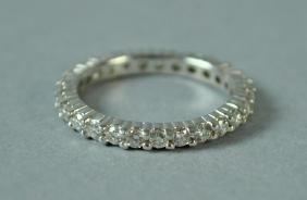 PLATINUM & DIAMOND ETERNITY RING, 0.86CTW