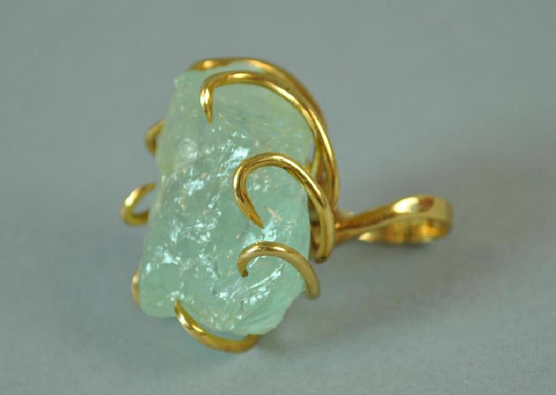 GOLD RING WITH LARGE ROUGH-CUT STONE