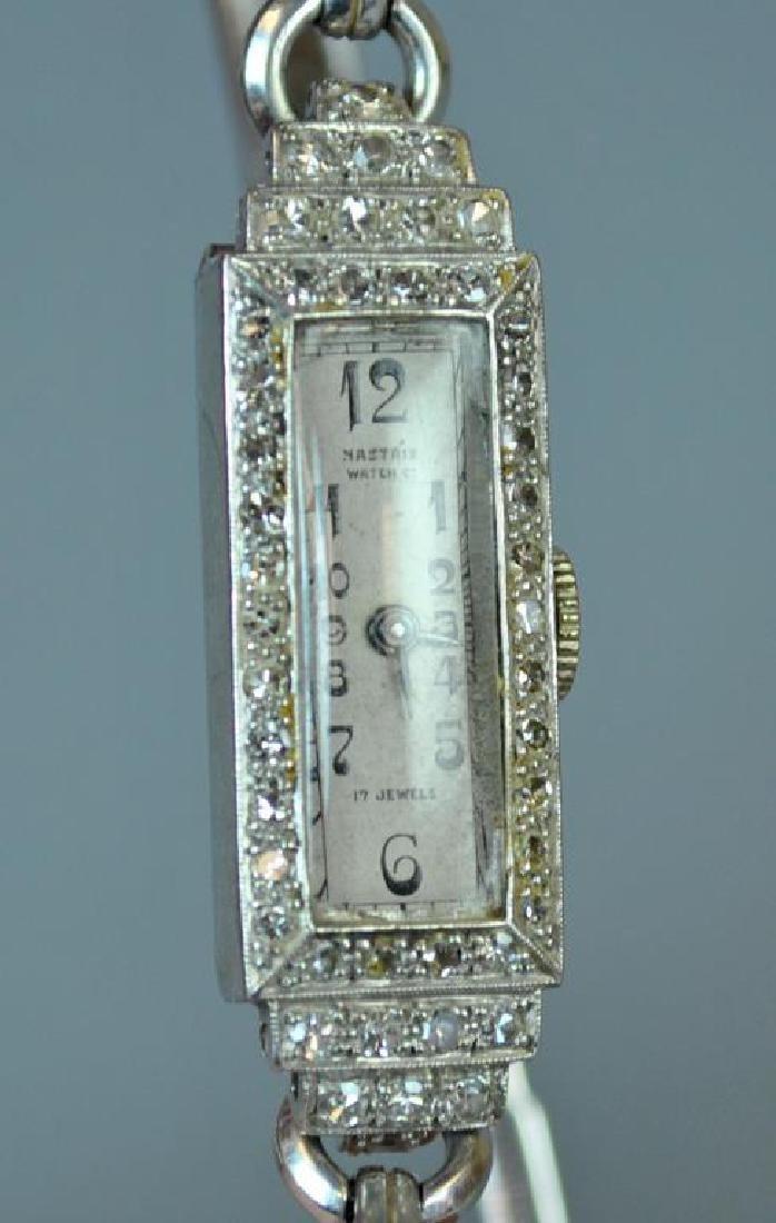 ART DECO DIAMOND & PLATINUM CASE LADIES WATCH
