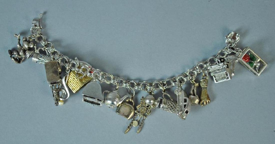 STERLING CHARM BRACELET WITH 17 SILVER CHARMS
