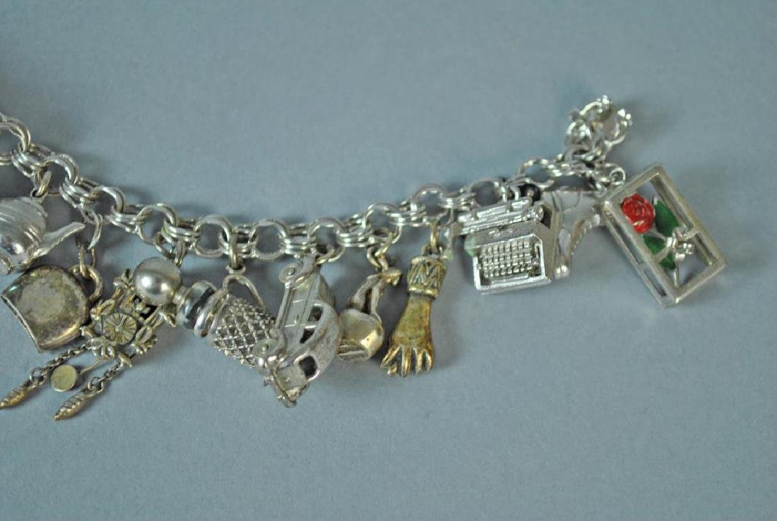 STERLING CHARM BRACELET WITH 17 SILVER CHARMS - 4