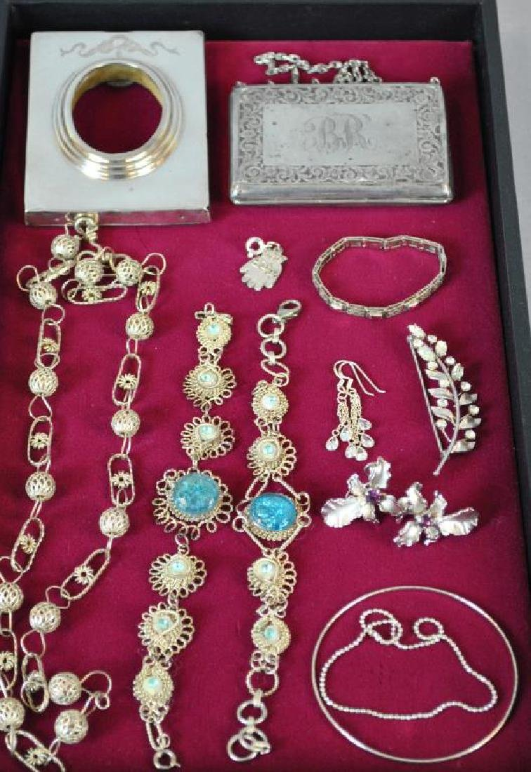 (2) SILVER ARTICLES AND (10) SILVERTONE JEWELRIES