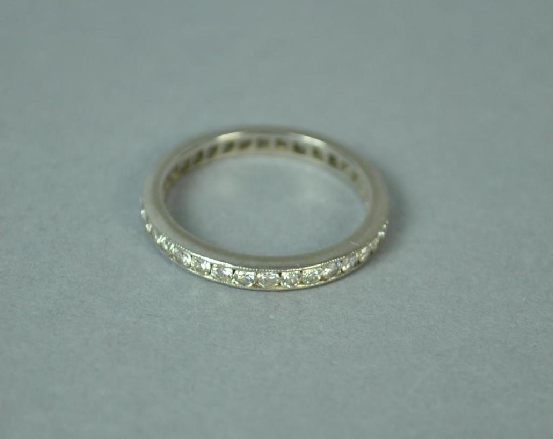 PLATINIM & DIAMOND ETERNITY BAND, 0.68CTW
