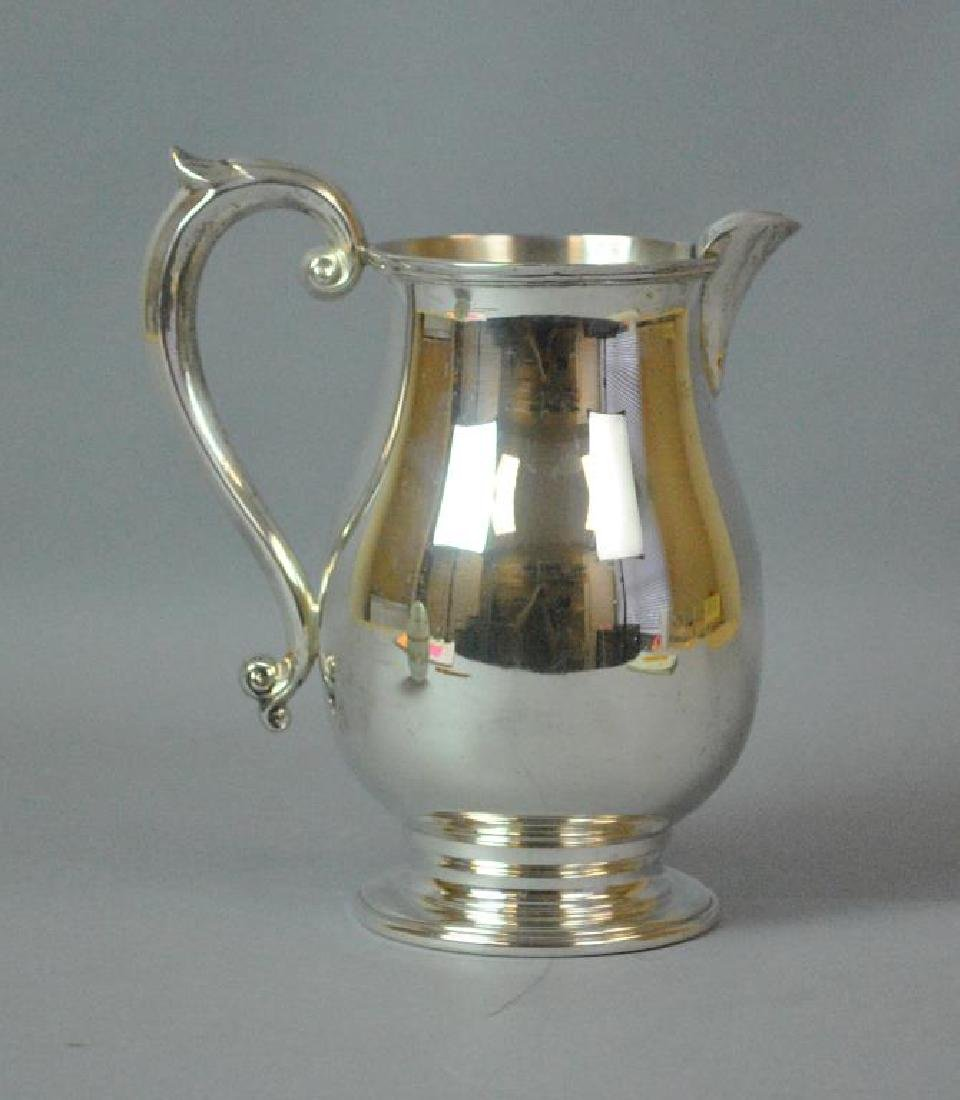 CARTIER STERLING FOOTED WATER PITCHER
