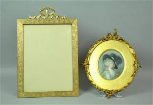 BRONZE EASEL PICTURE FRAME AND A PAINTED PORTRAIT