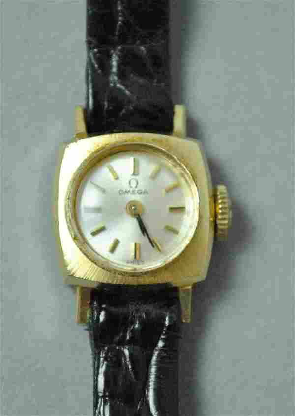 OMEGA CHILDS OR PETITE LADIES GOLD CASE WATCH