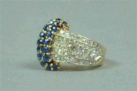 DIAMOND & SAPPHIRE BUCKLE FORM COCKTAIL RING