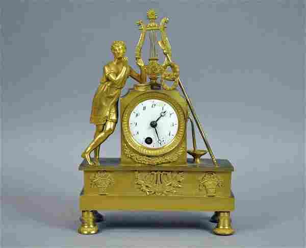 FRENCH EMPIRE FIGURAL GILT BRONZE MANTLE CLOCK