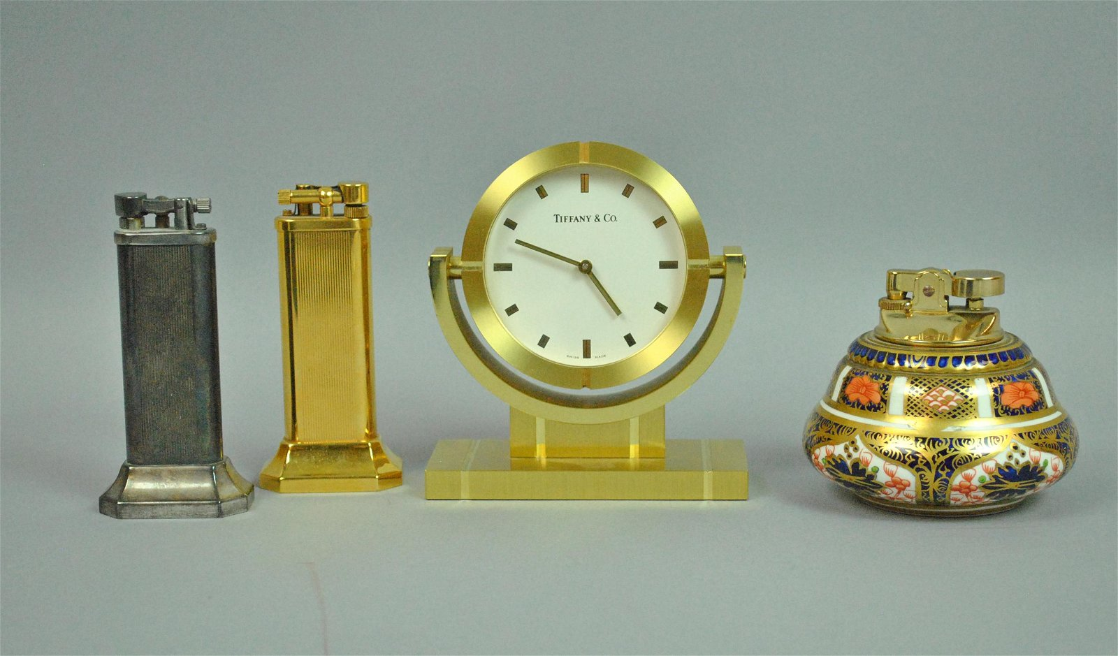 (3) LIGHTERS AND A TIFFANY DESK CLOCK