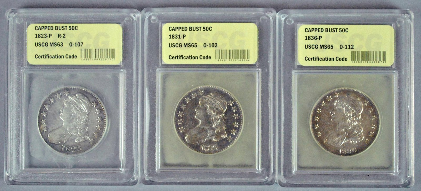 (3) GRADED CAPPED BUST US SILVER HALF DOLLAR COINS