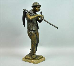 BRONZE FIGURE OF A FARMER SIGNED JAGER