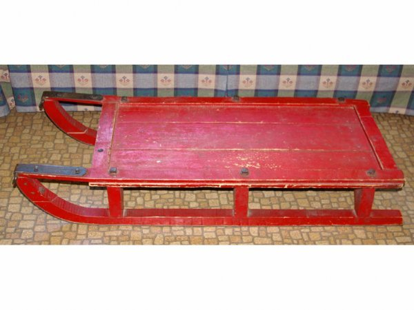 23: ANTIQUE RED-PAINTED SLED, length 46in.