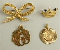 255 4PIECE 14K GOLD JEWELRY GROUP includes a knotted