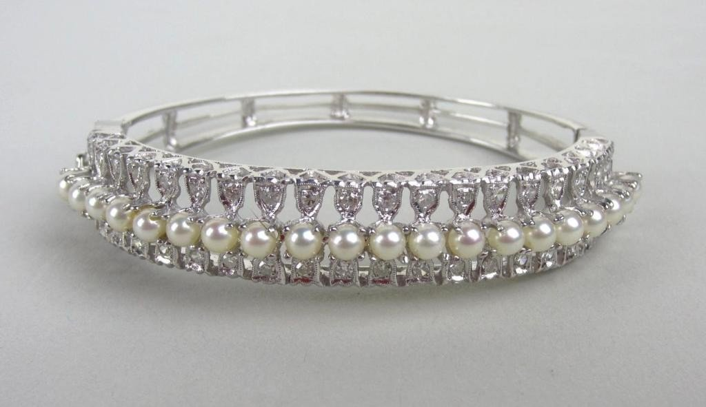131: DIAMOND AND SEED PEARL BANGLE, 0.80CTW