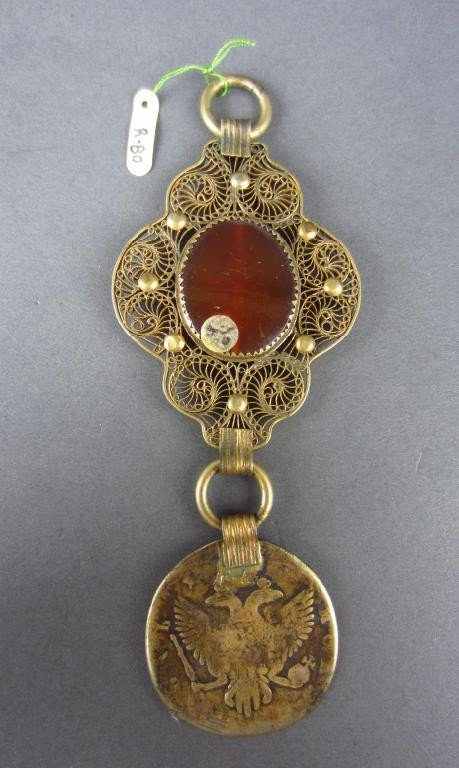 18: CARNELIAN FILIGREE PENDANT WITH ELIZABETH I RUBLE