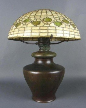TIFFANY STUDIOS ACORN SHADE AND BRONZE OIL LAMP