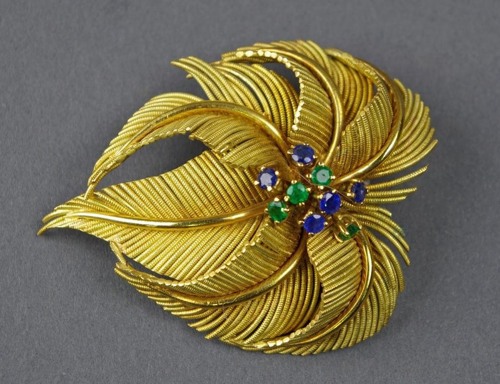 115: 18K SAPPHIRE AND EMERALD LEAF-FORM BROOCH