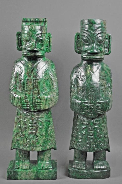 21: LARGE PAIR SANXINGDUI-STYLE CARVED STONE FIGURES