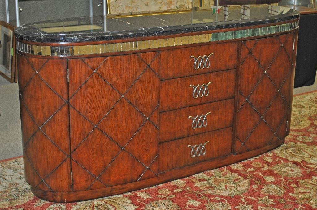 55: MARGE CARSON BLACK MARBLE-TOP SIDEBOARD