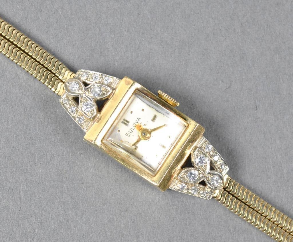62: LADIES GOLD AND DIAMOND BULOVA BRACELET WATCH