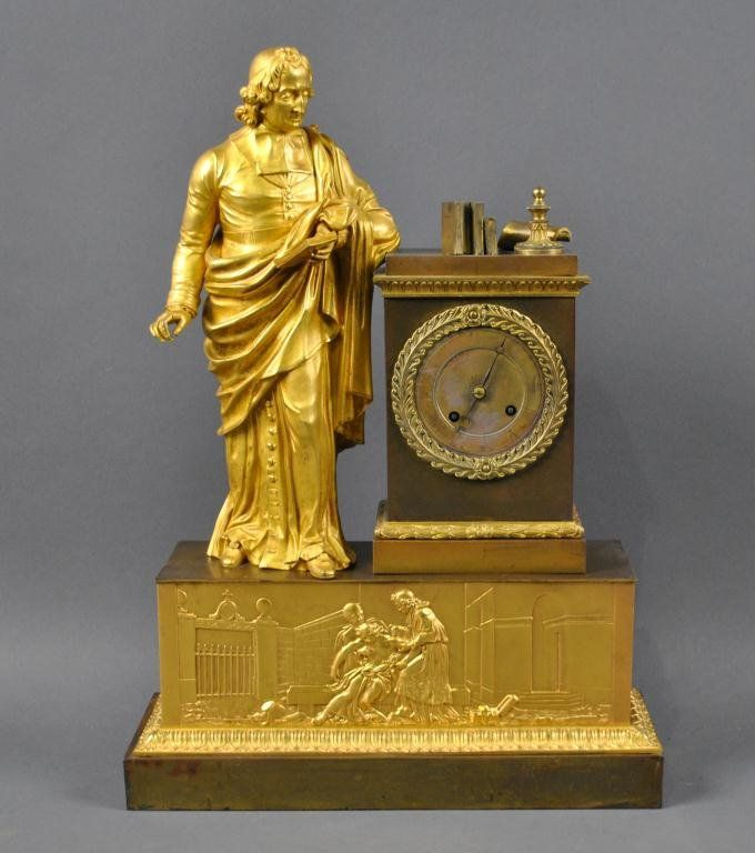 FRENCH EMPIRE GILT BRONZE FIGURAL MANTLE CLOCK