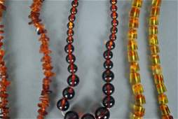 THREE AMBER OR AMBER-STYLE BEADED NECKLACES