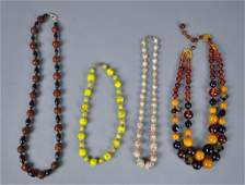FOUR VINTAGE BEADED NECKLACES