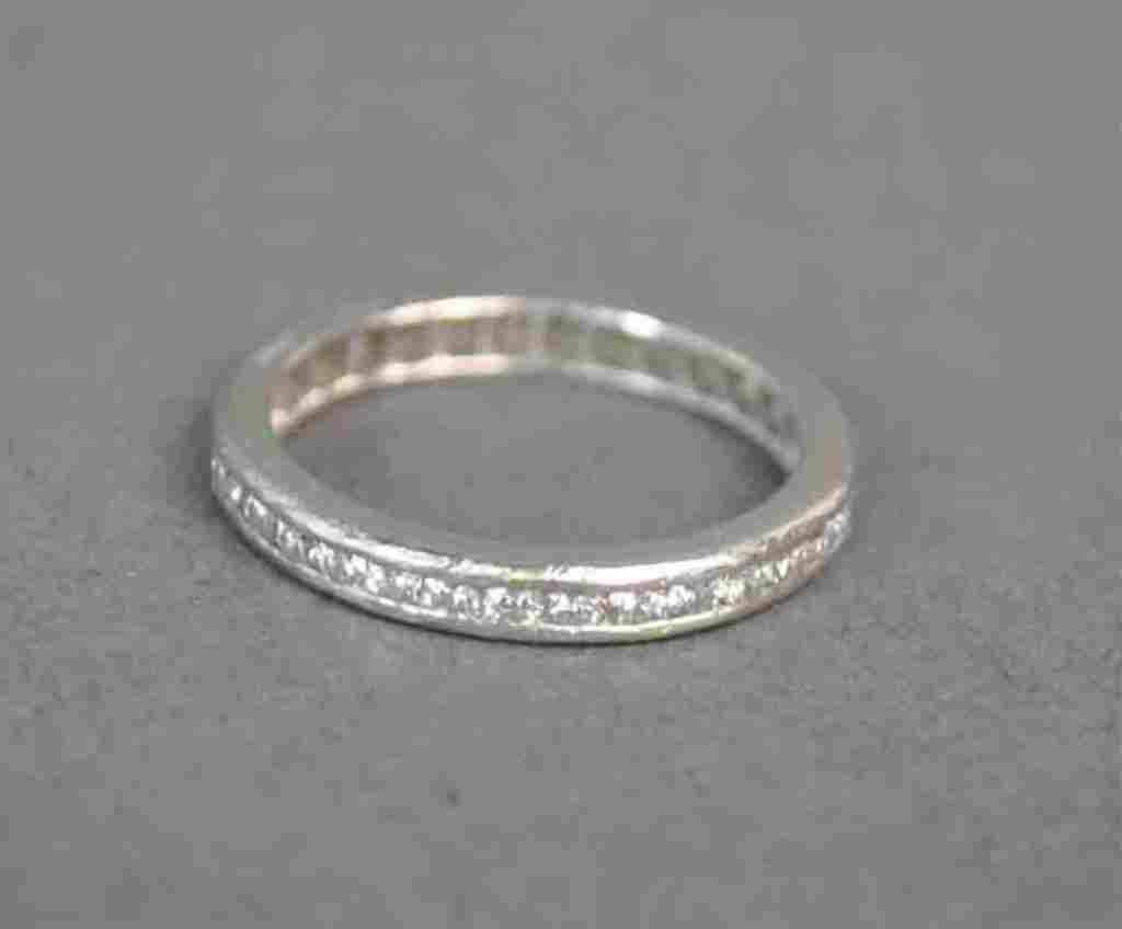 PLATINUM & DIAMOND ETERNITY BAND, 0.50CTW