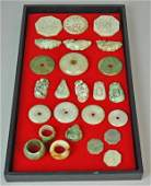 25 CONTEMPORARY CHINESE CARVED STONE PENDANTS