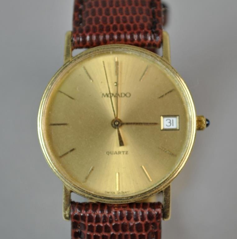 GENTS MOVADO GOLD CASE WATCH