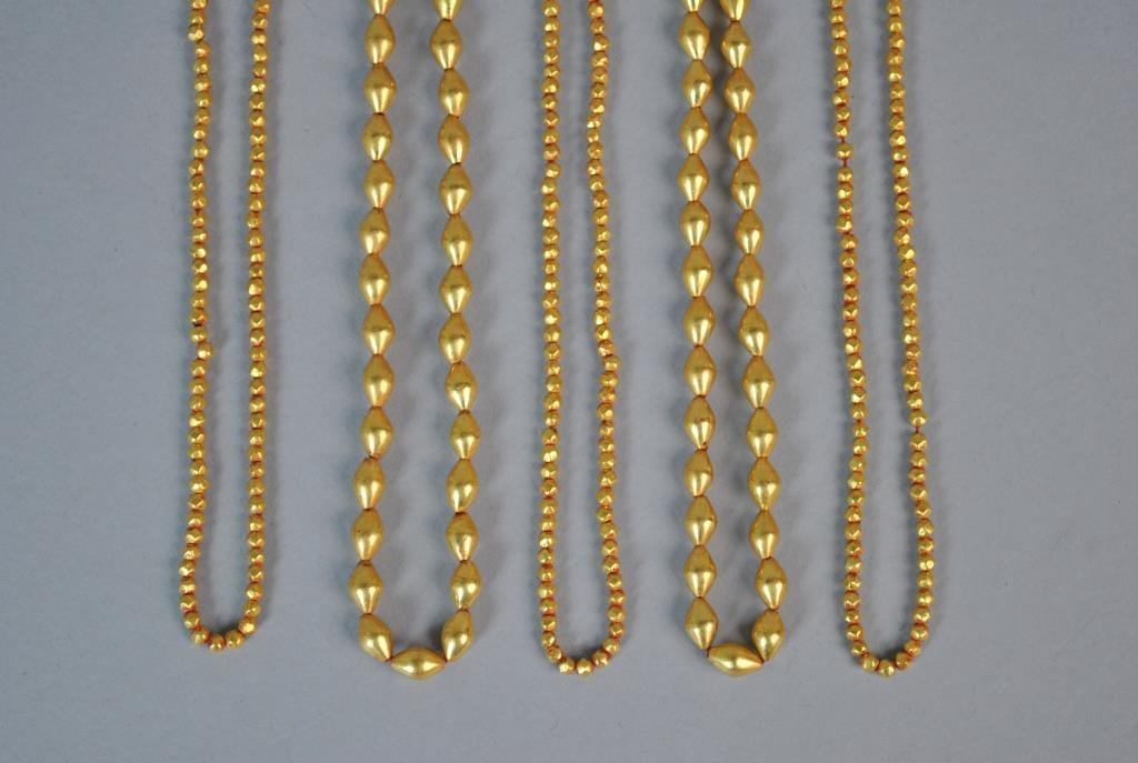 LOOSE STRINGS OF GOLD BEADS