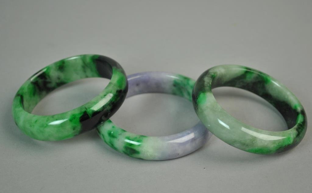 (3) CONTEMPORARY CHINESE JADE BANGLES