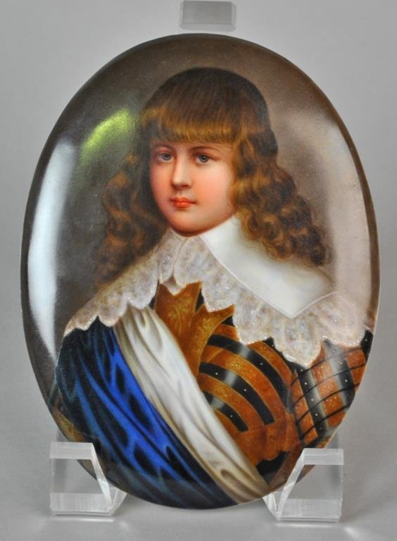 PORCELAIN PLAQUE OF A YOUNG BOY