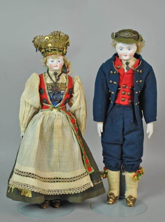 PAIR OF AUSTRIAN BISQUE HEAD DOLLS