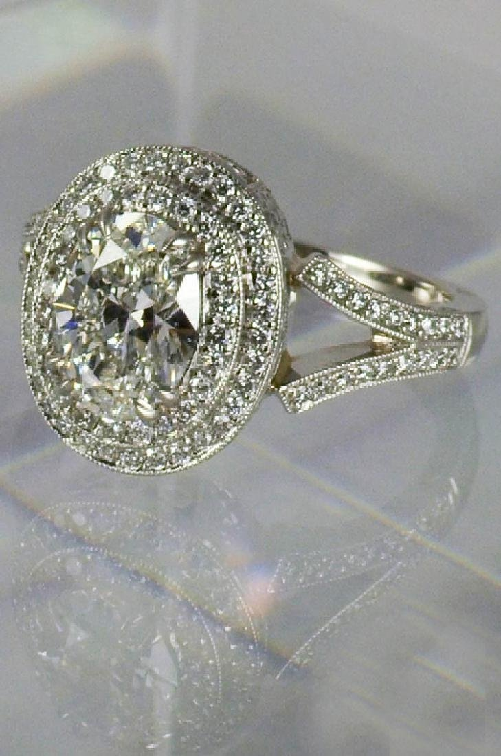 MICHAEL BEAUDRY PLATINUM RING WITH A 1.32 CARAT OVAL