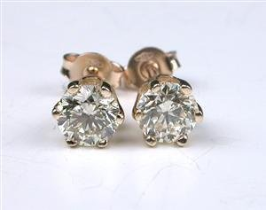 1016:  Yellow gold earring, 1.40ct