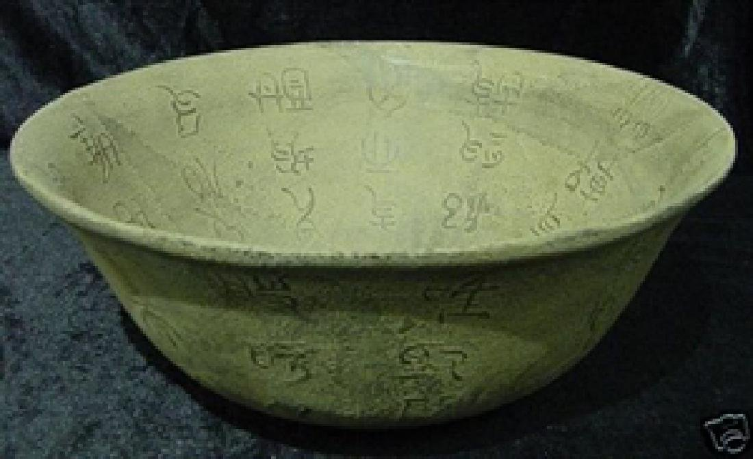 ANTIQUE JADE BOWL WITH CHARACTERS