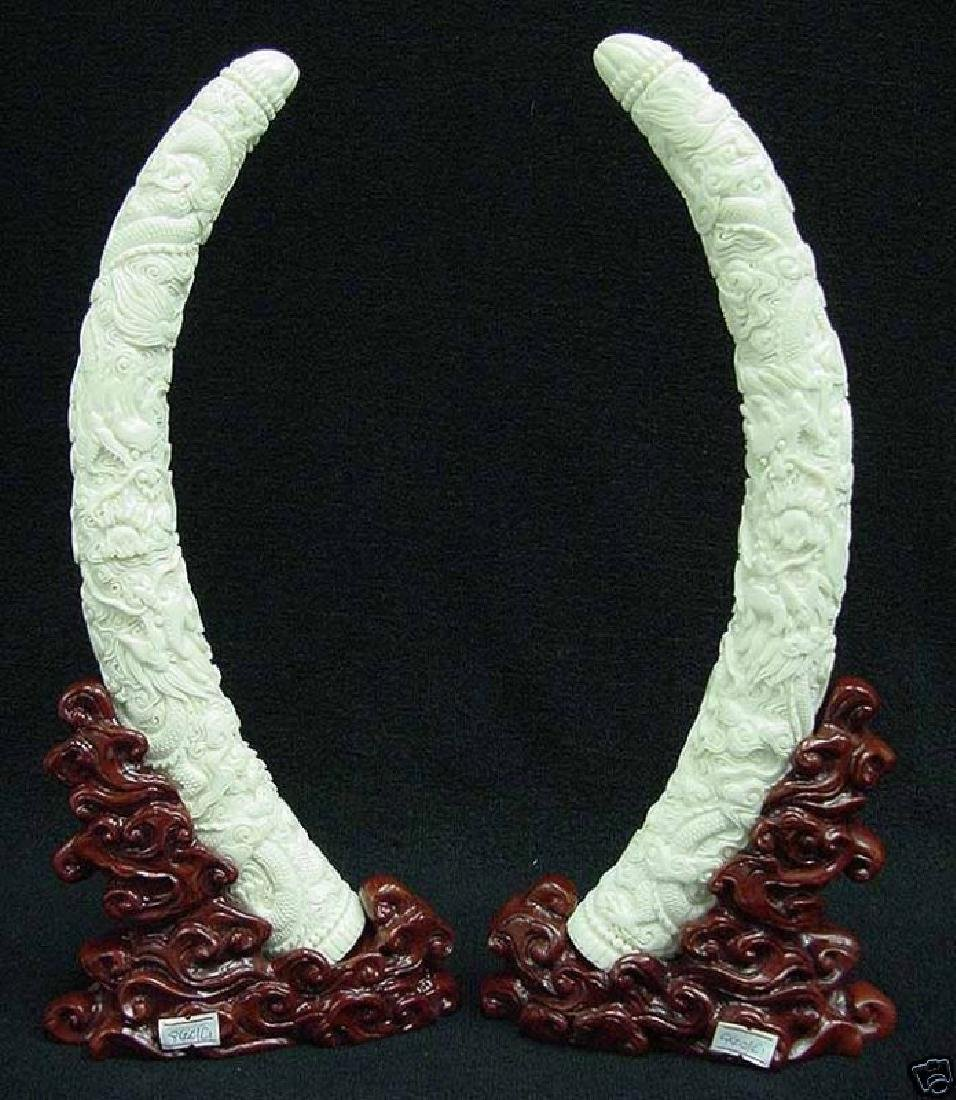 PAIR OF COW BONE DRAGON TUSKS