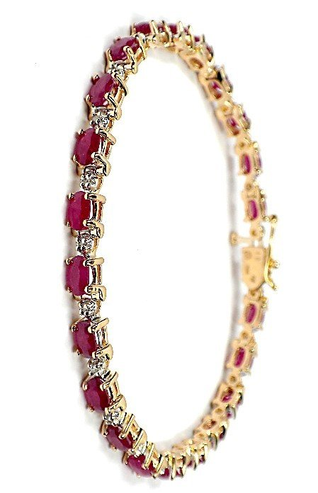 55: AIG Certified 14KT Yellow gold ruby and diamond bra