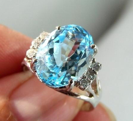 56: Blue Topaz & Diamond Ring - Appraised at $8,070