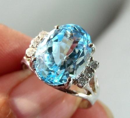 21: Blue Topaz & Diamond Ring - Appraised at $8,070