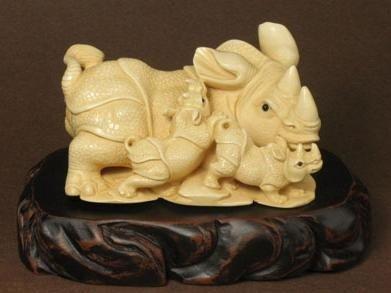 "24: Mammoth Ivory ""3 Rhinoceros - Father & 2 Babies"" Ca"