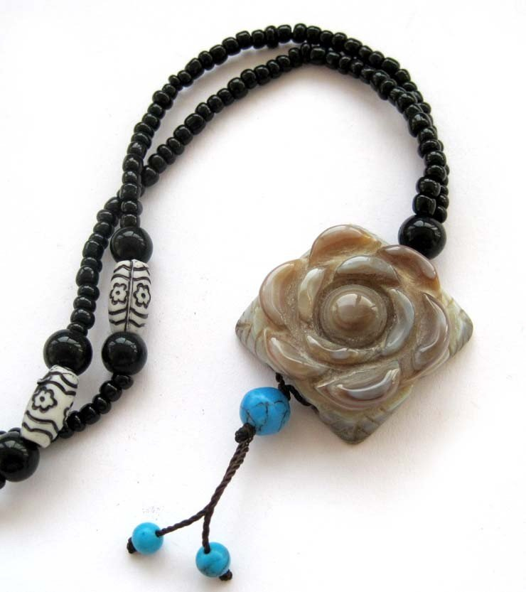 14: 300 CT Tibetan Style Necklace with Jade Flower Pend