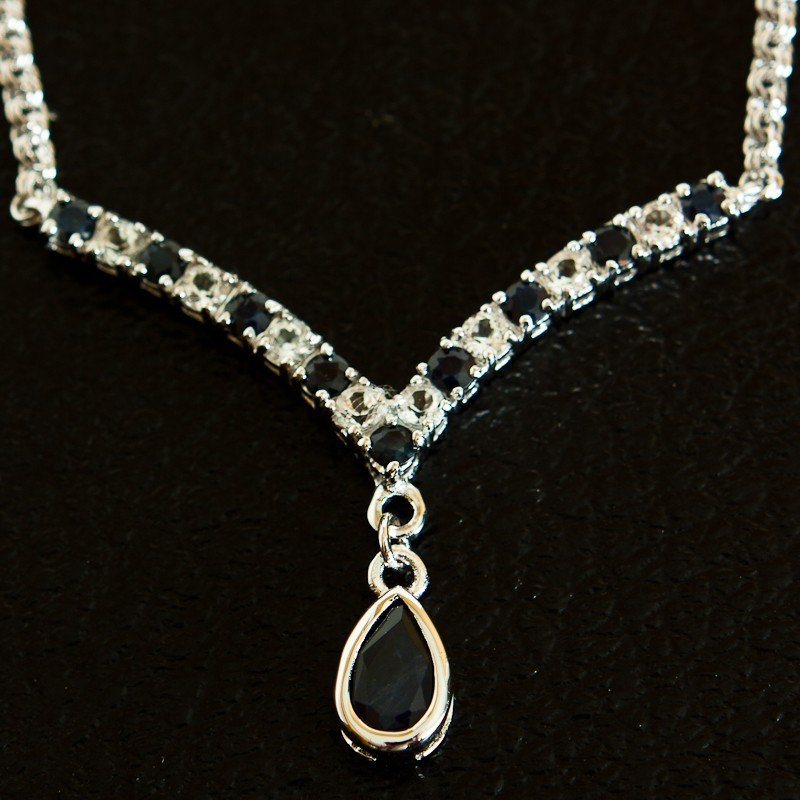 79: 4 CT Blue Sapphire and White Sapphire Necklace