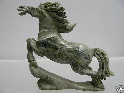 126: HAND CARVED NATURAL JADE RUNNING HORSE