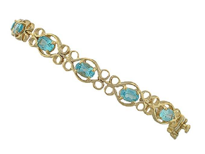 197: 9 CT Blue Topaz Diamond Pattern Bracelet