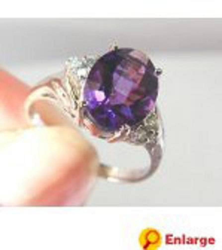 36: Amethyst and Diamond ring - Appraised at $7,850