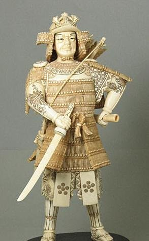 44: Mammoth Ivory Samuria Holding Sword Carving
